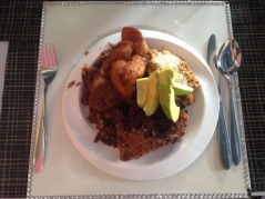 Jollof, beans, garri, friend plantains, fish and avocado (pear)