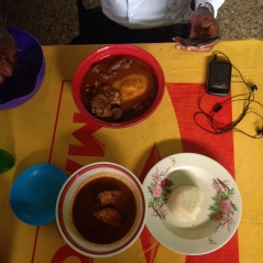 Bottom: banku, fish and light soup Top: fufu, goat and soup (unknown)